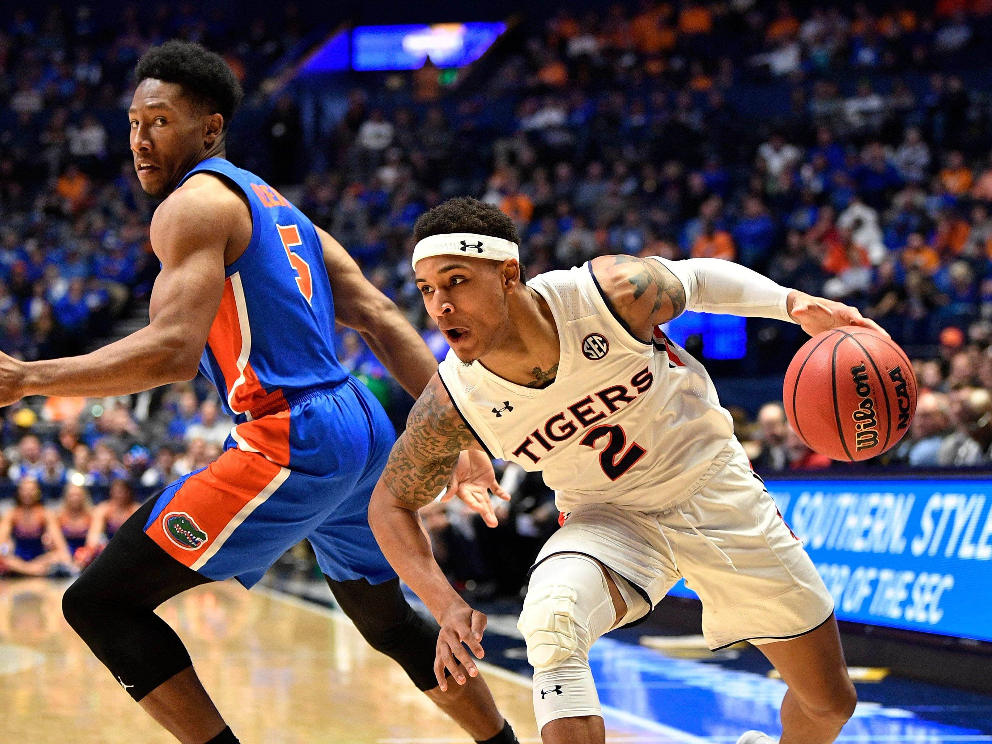 Auburn guard Bryce Brown (2) moves the ball defended by Florida guard KeVaughn Allen (5) during the second half of the SEC Men's Basketball Tournament game at Bridgestone Arena in Nashville, Tenn., Saturday, March 16, 2019.