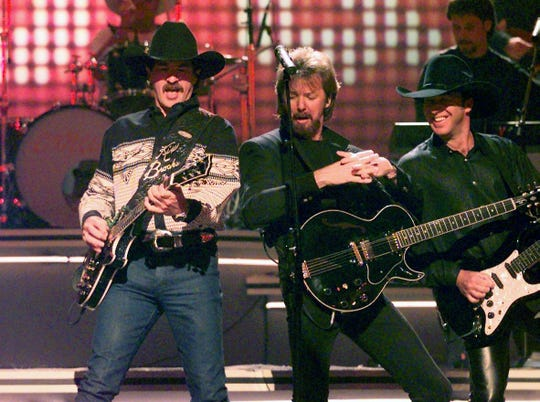 Brooks & Dunn perform one of their hits during the CMA Awards show at the Grand Ole Opry House Sept. 24, 1997.