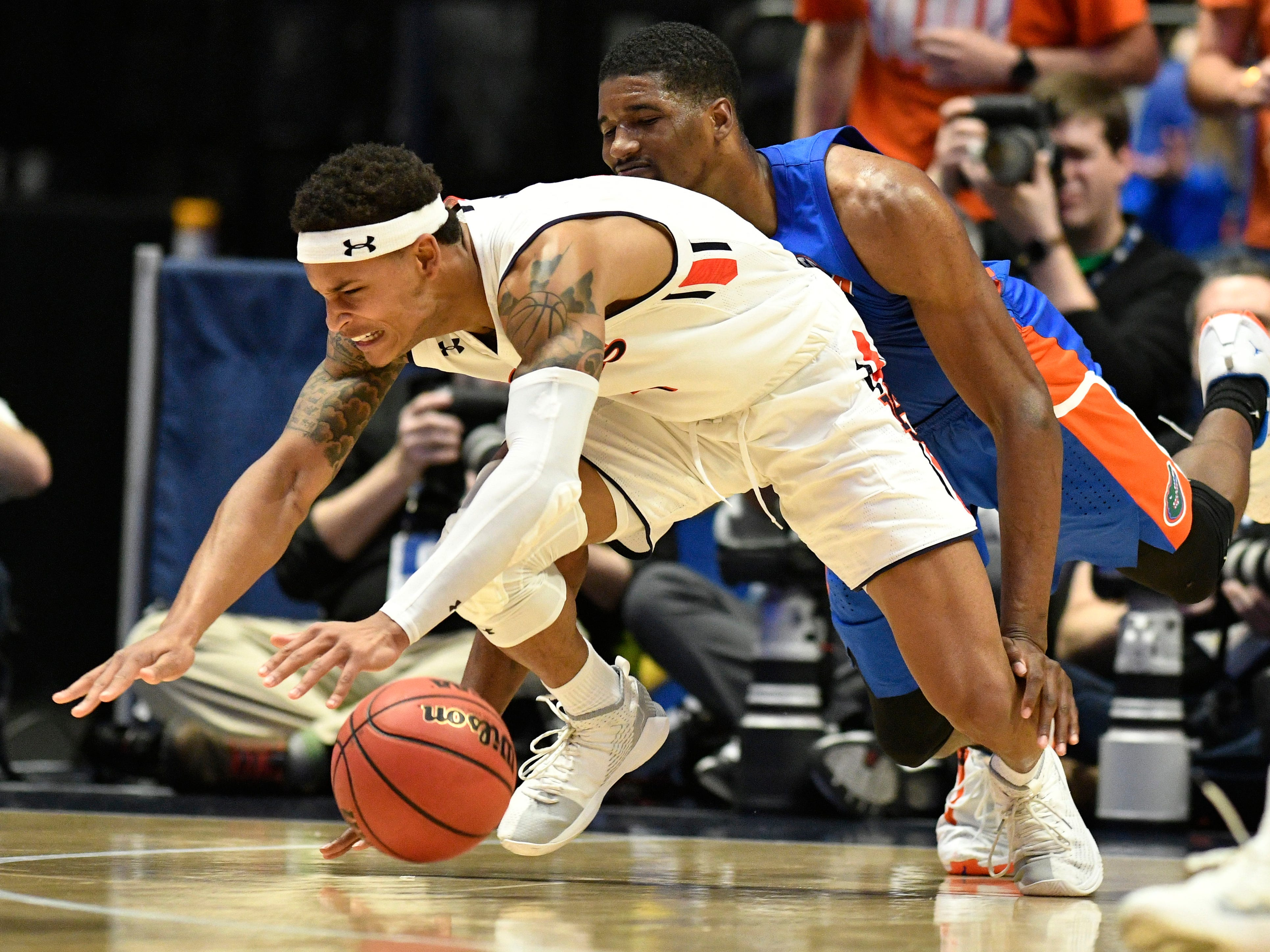 Auburn guard Bryce Brown (2) battles for the ball with Florida center Kevarrius Hayes (13) during the second half of the SEC Men's Basketball Tournament game at Bridgestone Arena in Nashville, Tenn., Saturday, March 16, 2019.