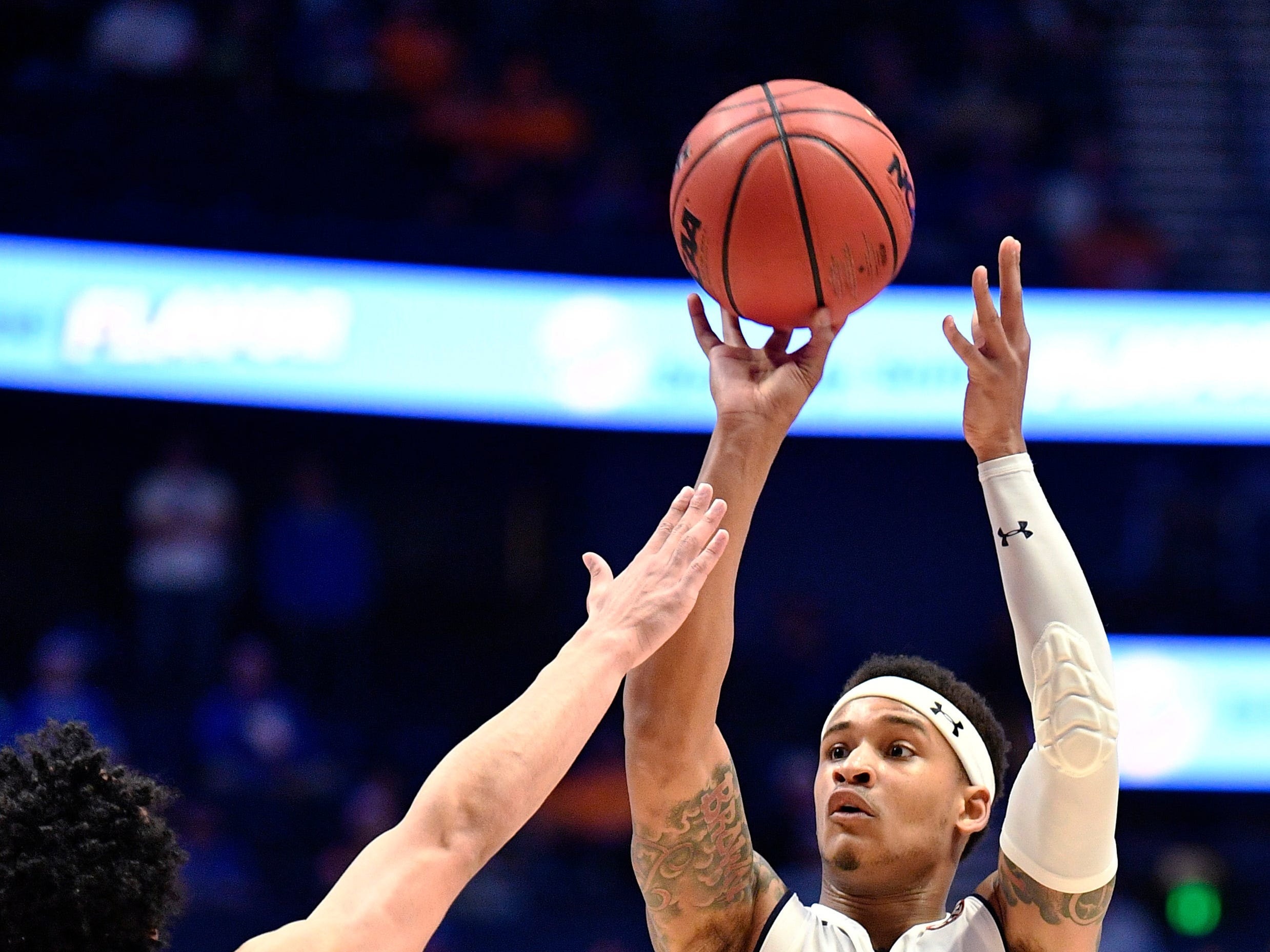 Auburn guard Bryce Brown (2) goes up for a shot defended by Florida guard Andrew Nembhard (2) during the second half of the SEC Men's Basketball Tournament game at Bridgestone Arena in Nashville, Tenn., Saturday, March 16, 2019.