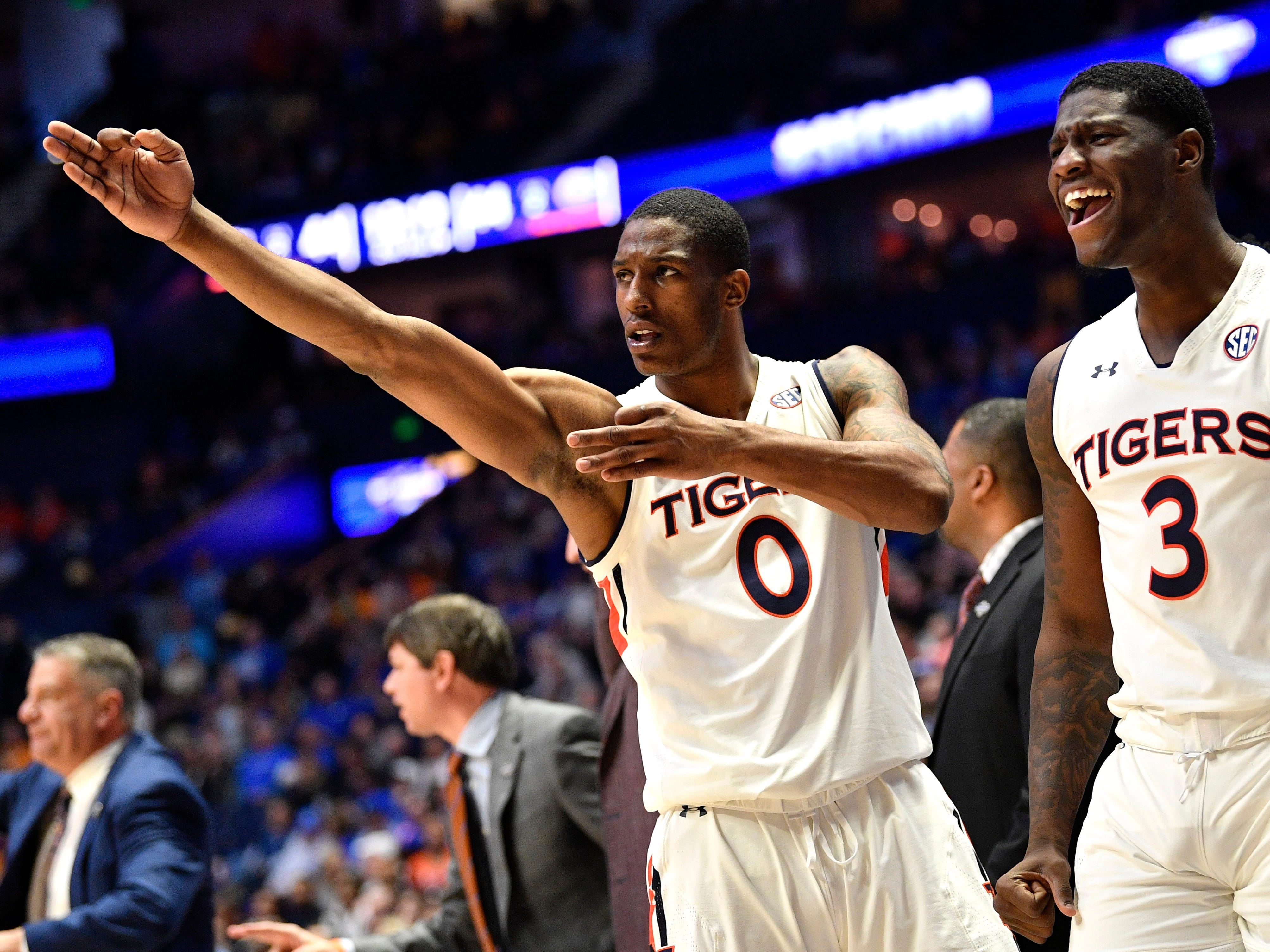 Auburn forwards Horace Spencer (0) and Danjel Purifoy (3) celebrate during the second half of the SEC Men's Basketball Tournament game against Florida at Bridgestone Arena in Nashville, Tenn., Saturday, March 16, 2019.