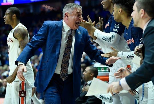 Auburn head coach Bruce Pearl slaps hands during the first half of the SEC Men's Basketball Tournament game against Florida at Bridgestone Arena in Nashville, Tenn., Saturday, March 16, 2019.