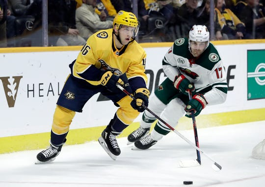 Nashville Predators defenseman Matt Donovan (46) chases the puck with Minnesota Wild left wing Marcus Foligno (17) on March 5, 2019.