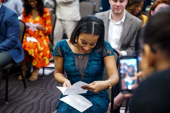 Laetitia Badio opens the letter to find out where she has been accepted for her residency during Match Day at Meharry Medical College on March 15.