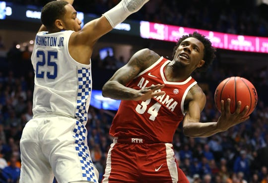 Alabama guard Tevin Mack (34) looks to shoot defended by Kentucky forward PJ Washington (25) during the first half of the SEC Men's Basketball Tournament game at Bridgestone Arena in Nashville, Tenn., Friday, March 15, 2019.