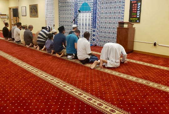 """Members of the Islamic Center of Naples say their night prayers on Friday, March 15, 2019. Imam Muhammad Nour said the Muslim community in Collier County was heartbroken over the news of mosque attacks in New Zealand. """"These are our brothers and sisters in faith,"""" he said."""