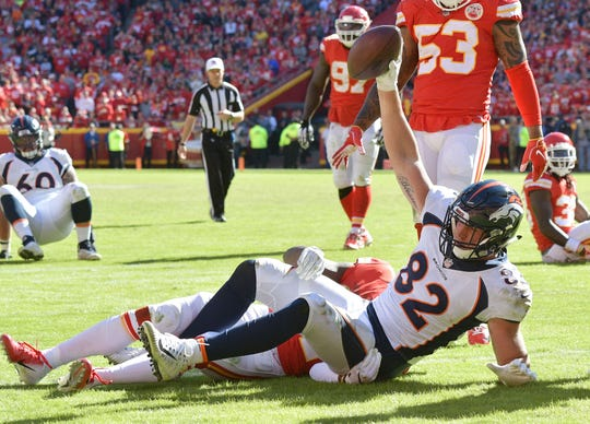Denver Broncos tight end Jeff Heuerman (82) catches a pass for a touchdown against Kansas City Chiefs strong safety Eric Murray (21) during the second half at Arrowhead Stadium last season.