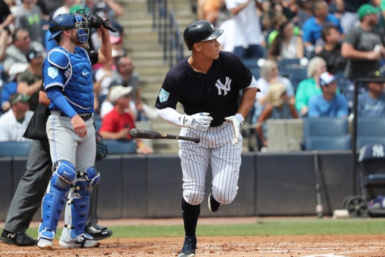 Mar 16, 2019; Tampa, FL, USA; New York Yankees designated hitter Aaron Judge (99) hits a home run during the first inning against the Toronto Blue Jays at George M. Steinbrenner Field.