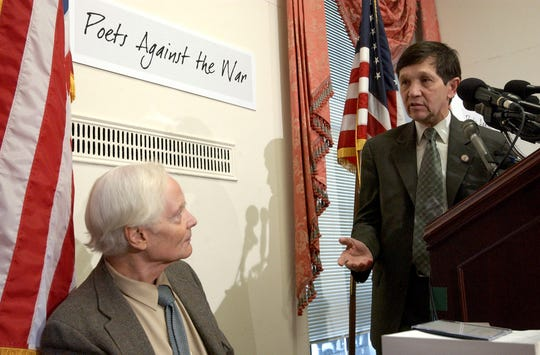 FILE -- In this March 5, 2003 file photo, U.S. Rep. Dennis Kucinich, D-Ohio, right, gestures toward Pulitzer Prize winning poet W.S. Merwin during a Capitol Hill news conference. Merwin, a prolific and versatile master of modern poetry who evolved through a wide range of styles as he celebrated nature, condemned war and industrialism and reached for the the elusive past, died on Friday, March 15, 2019 at his home in Hawaii. A Pulitzer Prize winner and former U.S. poet laureate, Merwin completed more than 20 books and ranked high in the pantheon for decades, from early works inspired by myths and legends to late meditations on age and time.
