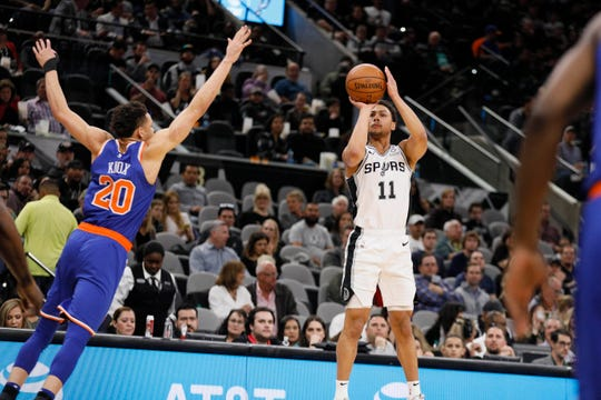 Mar 15, 2019; San Antonio, TX, USA; San Antonio Spurs shooting guard Bryn Forbes (11) shoots the ball over New York Knicks small forward Kevin Knox (20) during the first half at AT&T Center.