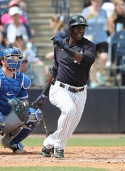 Mar 16, 2019; Tampa, FL, USA; New York Yankees center fielder Estevan Florial (92) singles during the fourth inning against the Toronto Blue Jays at George M. Steinbrenner Field.