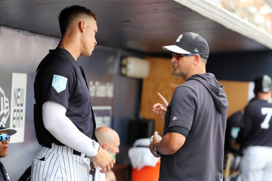Mar 16, 2019; Tampa, FL, USA; New York Yankees manager Aaron Boone (17) talks with designated hitter Aaron Judge (99) during the first inning in the dugout against the Toronto Blue Jays at George M. Steinbrenner Field.