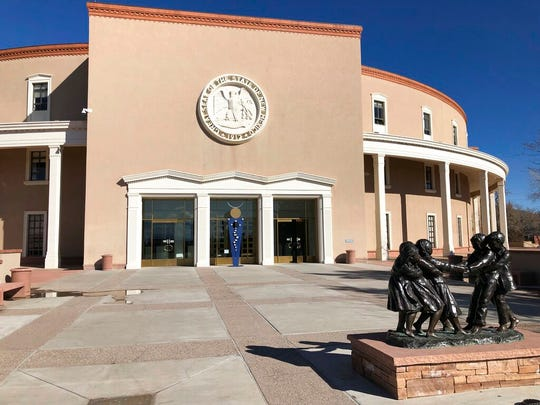 The New Mexico Roundhouse sits quietly as lawmakers debate final bills inside on Friday, March 15, 2019, in Santa Fe, N.M. The Democratic-controlled New Mexico Legislature is racing to pass a number of measures around taxes and minimum wage before the current session ends on Saturday, March 16, 2019. (AP Photo/Russell Contreras)