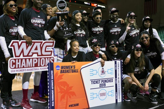 The New Mexico State women's team poses after winning the WAC Tournament on Saturday, March 16, 2019, at the Orleans Arena in Las Vegas.