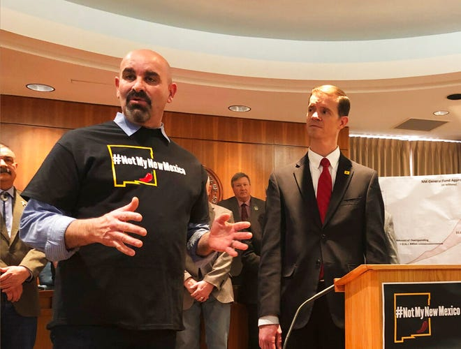 New Mexico GOP House Minority Whip Rep. Rod Montoya, R-Farmington, left, and Rep. Jason Harper, R-Rio Rancho, right, denounce Democratic-sponsored bills on Saturday, March 16, 2019, in Santa Fe, N.M. The Democratic-controlled New Mexico Legislature ended Saturday, March 16, 2019, after passing bills to increase education spending and create an independent ethics commission.