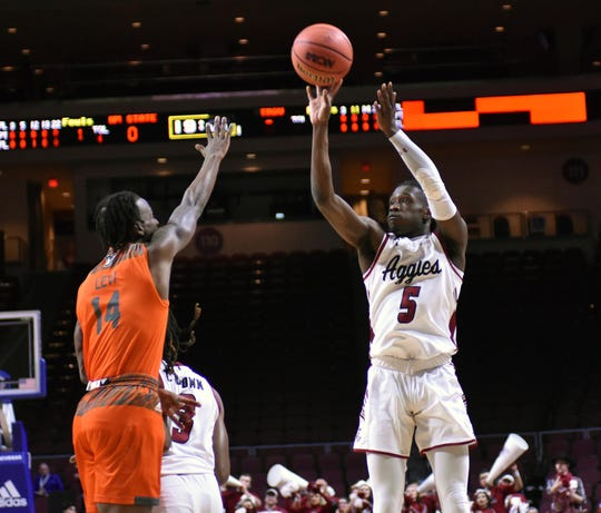 New Mexico State's Clayton Henry shoots and makes a 3-point shot against UT-Rio Grande Valley in a WAC Tournament semifinal game Friday, March 15, 2019, at the Orleans Arena in Las Vegas, Nevada.