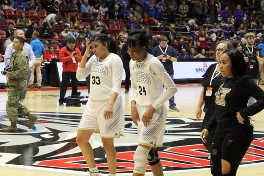 Hobbs' Mariah Jennings (33) and Ayanna Smith (24) leave the floor of The Pit after losing in the Class 5A championship game against West Mesa, 63-51 on Saturday.