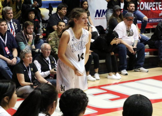 Hobbs' MacKenzye Gibson cries as she fouls out in the fourth quarter of Saturday's Class 5A championship game against West Mesa. West Mesa won the title, 61-51.