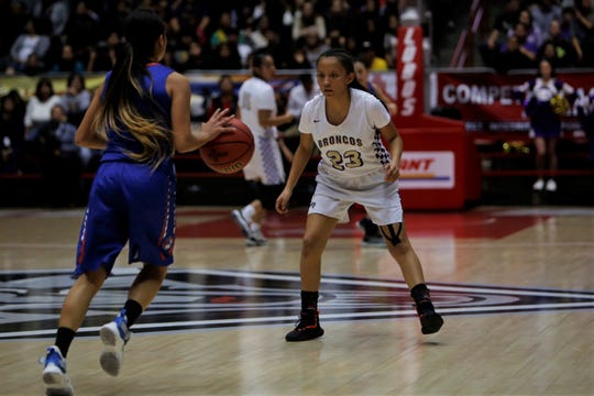 Kirtland Central's Avery Begay looks to get a defensive stop against Los Lunas' Marissa Weldon during Friday's 4A state championship game at Dreamstyle Arena in Albuquerque.