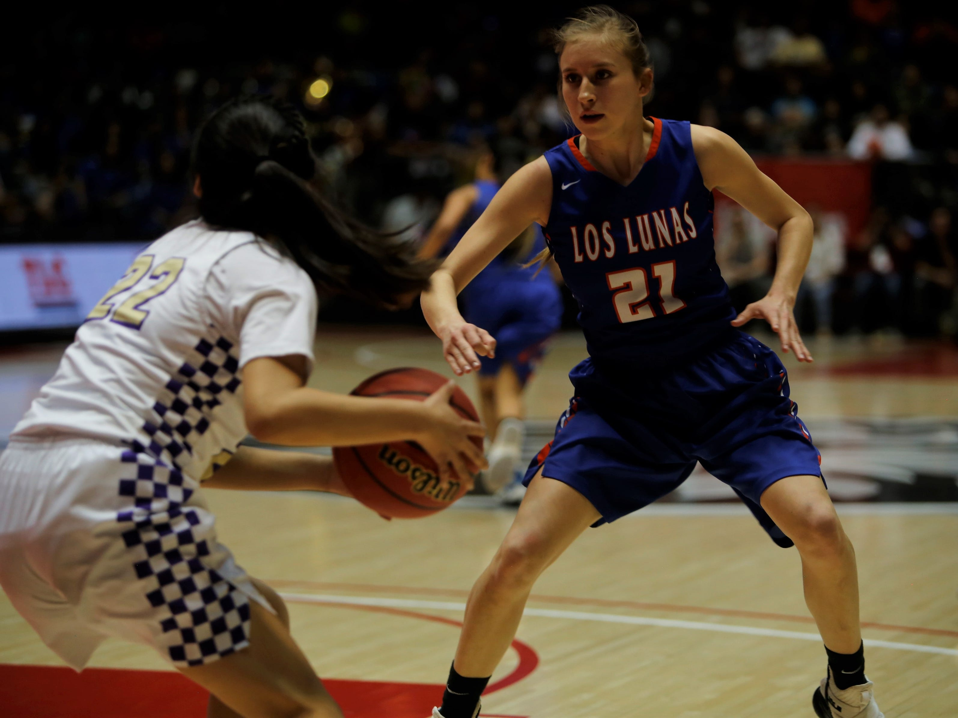 Los Lunas' Jaidyn Schollander looks to get a defensive stop against Kirtland Central's Tatelyn Maheimer during Friday's 4A state championship game at Dreamstyle Arena in Albuquerque.