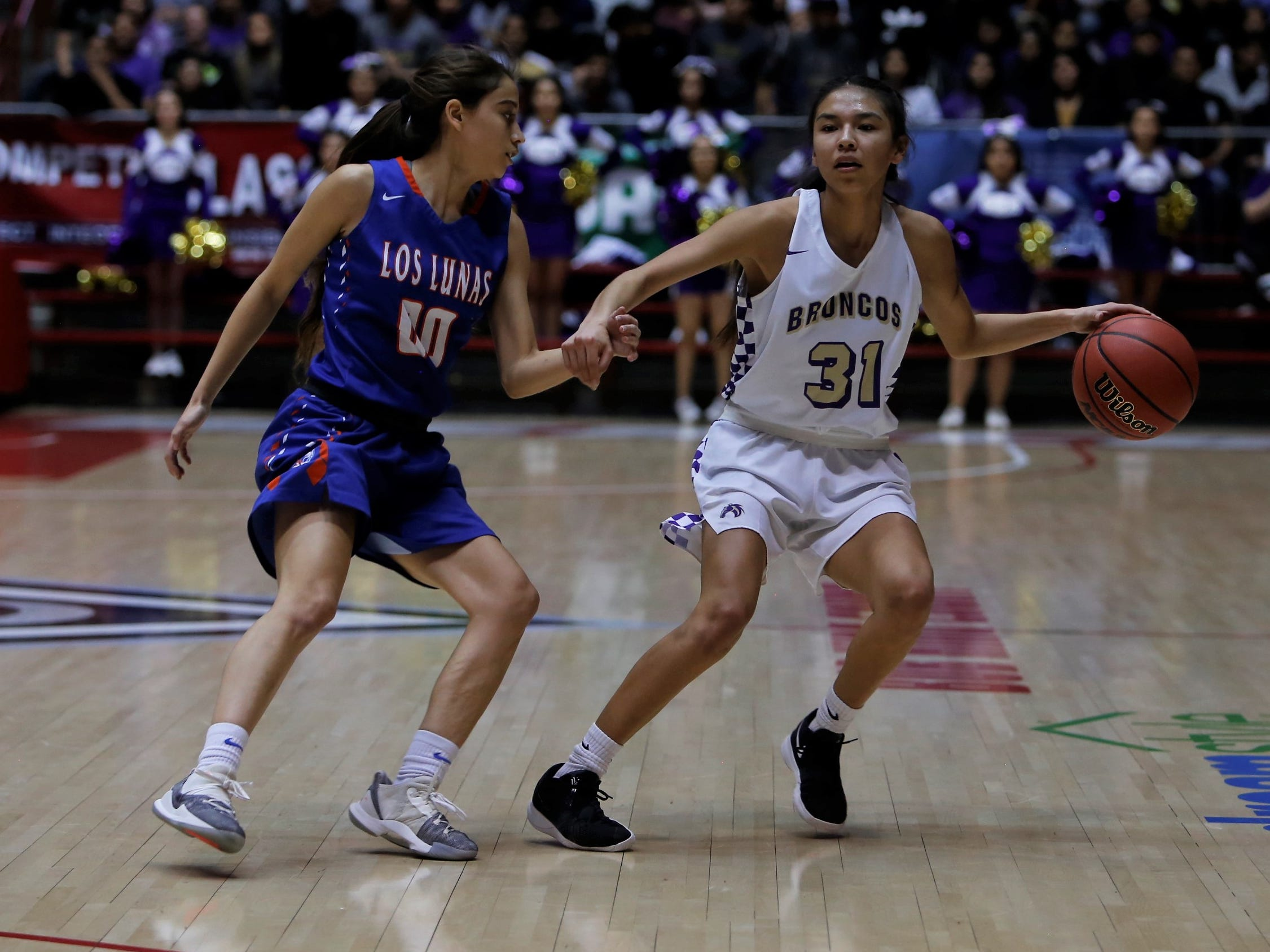 Kirtland Central's Tiajhae Nez fends off Los Lunas' Jaci Aragon during Friday's 4A state championship game at Dreamstyle Arena in Albuquerque.