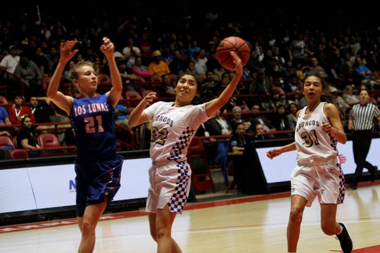 Kirtland Central's Tatelyn Manheimer deflects the ball for a steal against Los Lunas' Jaidyn Schollander during Friday's 4A state championship game at Dreamstyle Arena in Albuquerque.