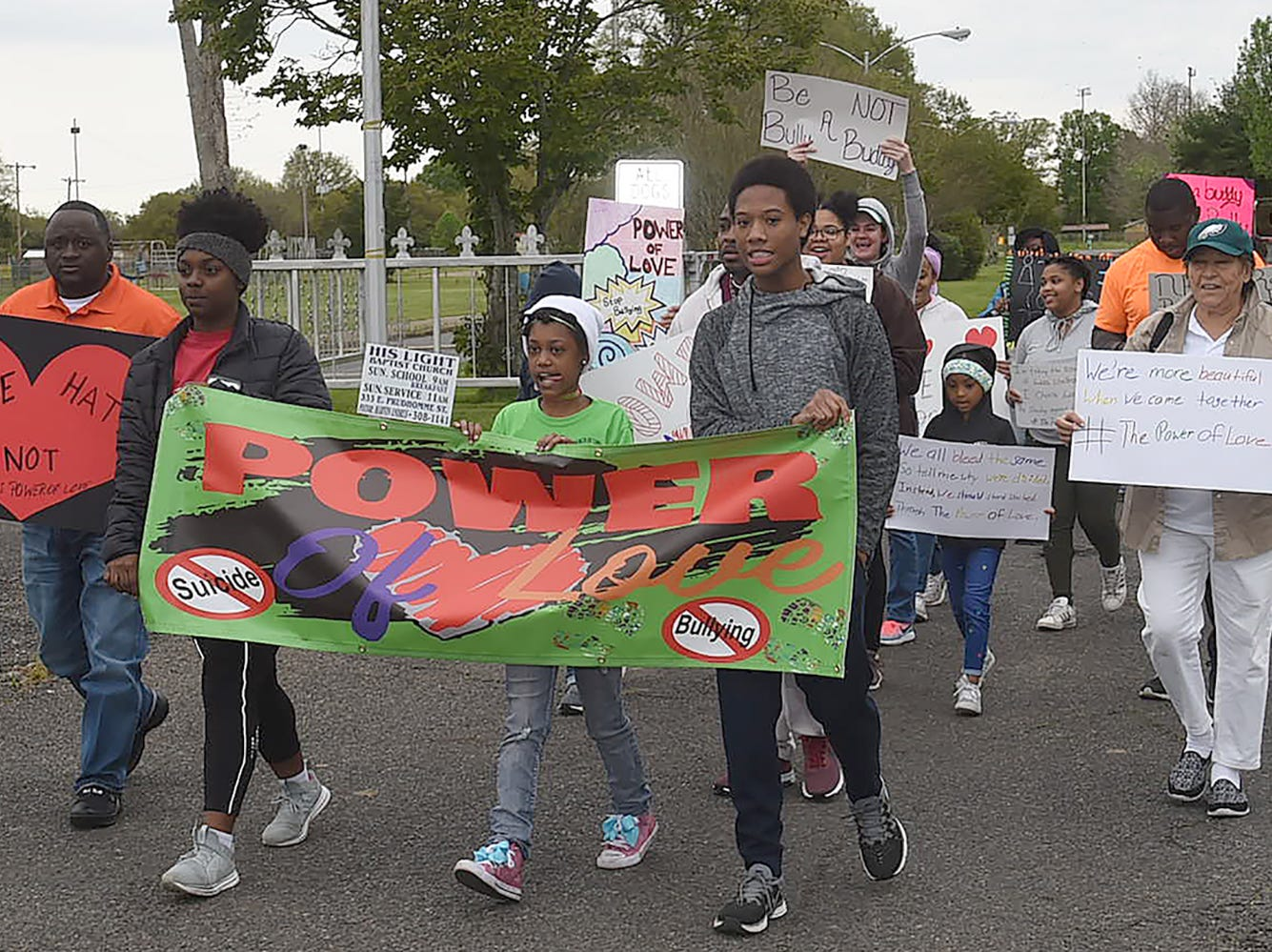 Opelousas residents make their way down Market Street from North City Park as they take part in the annual anti-bullying march Saturday morning. Organizer of the event was Beth Reed. Image may contain: 7 people, crowd and outdoor