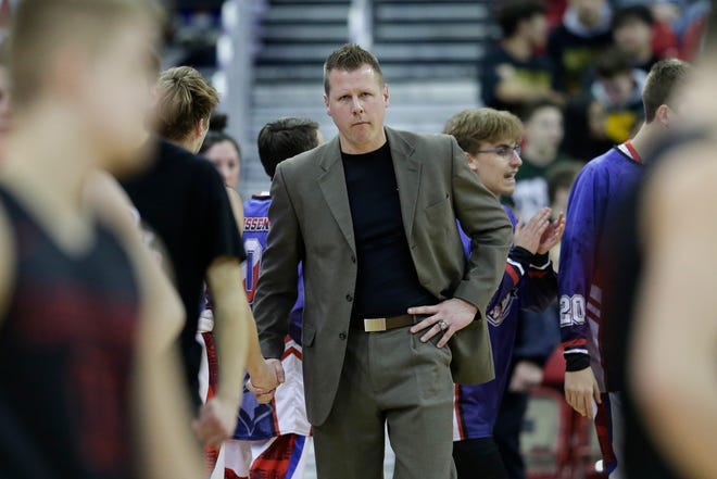 Lourdes Academy coach Brad Clark reacts after losing to New Glarus in the WIAA Division 4 boys basketball state championship game March 16 at the Kohl Center in Madison.