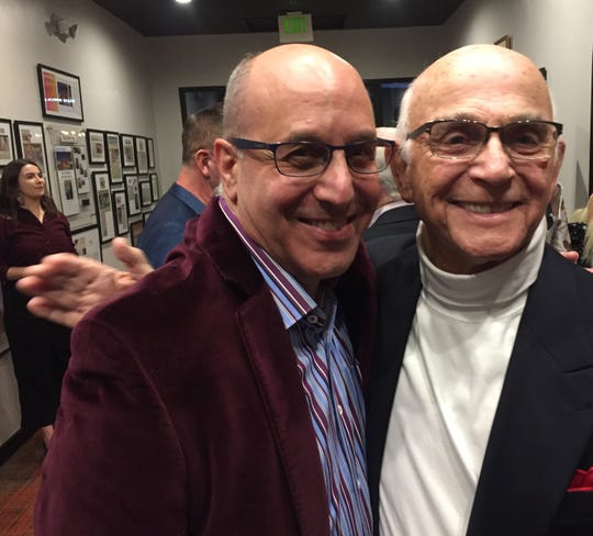 CVRep Artistic Director Ron Celona (left) received a hug from Rancho Mirage resident and long-time supporter Gavin MacLeod Friday at the opening of the CVRep Playhouse in Cathedral City.