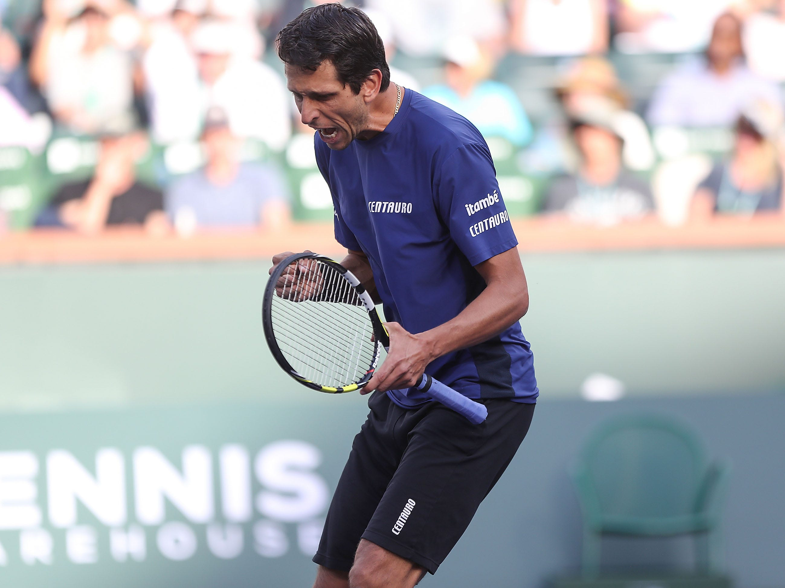 Marcelo Melo celebrates a point win during the doubles semifinal match at the BNP Paribas Open in Indian Wells, March 15, 2019.