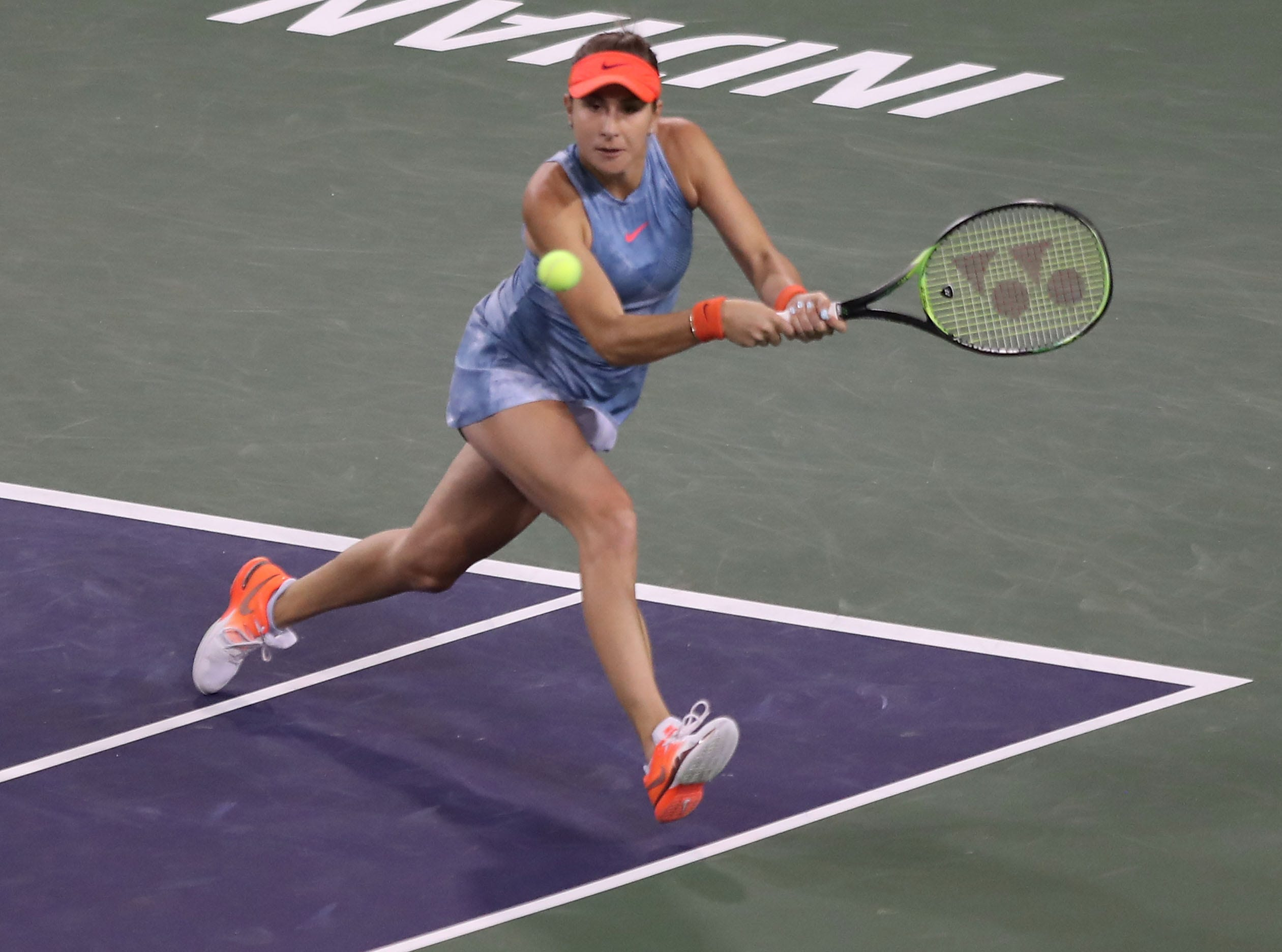Belinda Bencic hits during her loss to Angelique Kerber in the semifinal match at the BNP Paribas Open in Indian Wells, March 15, 2019.