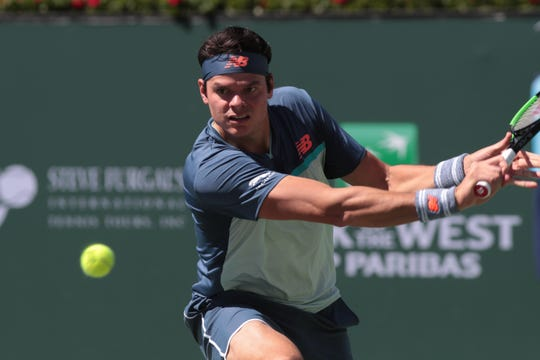 Milos Raonic prepares to hit a shot to Dominic Thiem in the semi-finals at the BNP Paribas Open in Indian Wells, Calif., March 16, 2019.