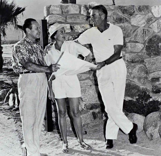 Handsome movie star Randolph Scott with his wife Pat and neighbor, publicity man Tony Burke, at the gate to Silver Spur Ranch.