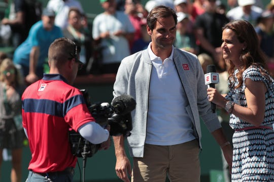 Roger Federer comes onto the stadium court at the BNP Paribas Open to announce that Rafael Nadal had to withdraw from their semi-final match due to injury, Indian Wells, Calif., March 16, 2019.