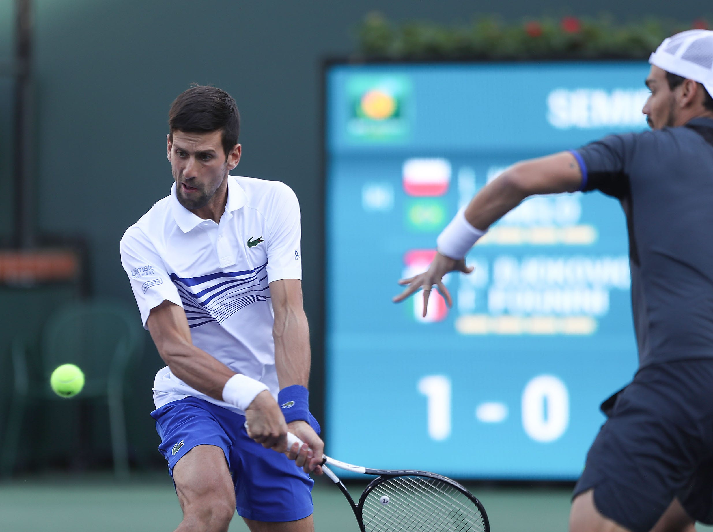 Novak Djokovic and Fabio Fognini play doubles against Lukasz Kubot and Marcelo Melo during the doubles semifinal match at the BNP Paribas Open in Indian Wells, March 15, 2019.