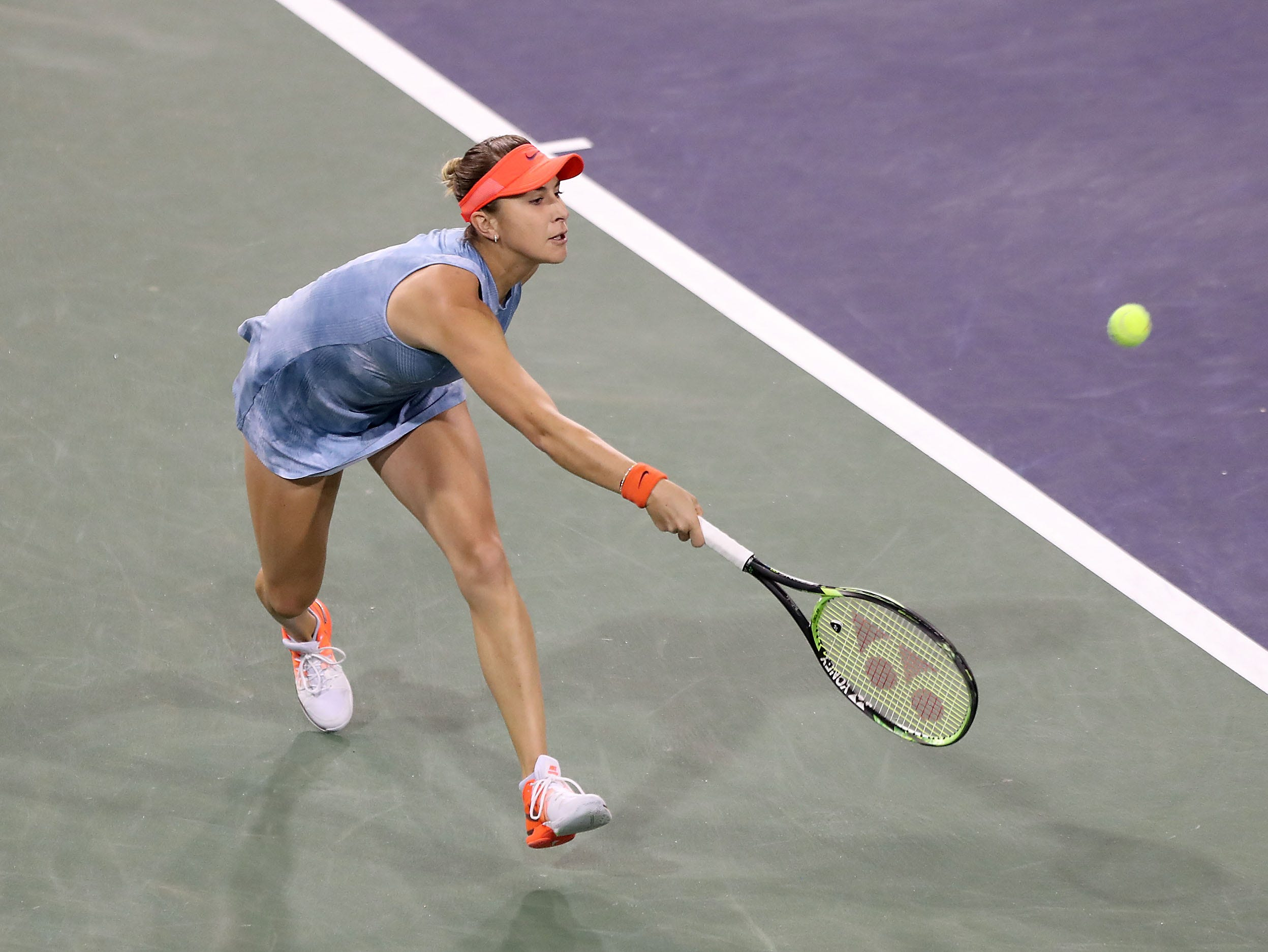 Belinda Bencic reaches for a shot during the semifinal match at the BNP Paribas Open in Indian Wells, March 15, 2019.