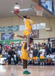 Dunk contest during the High School All-Star Basketball game at Pensacola State College in Pensacola on Friday, March 15, 2019.