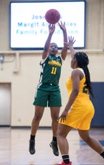 Khadija Chambless pulls up for a jumper during the West team's win at the Pensacola Sports High School All-Star Game.