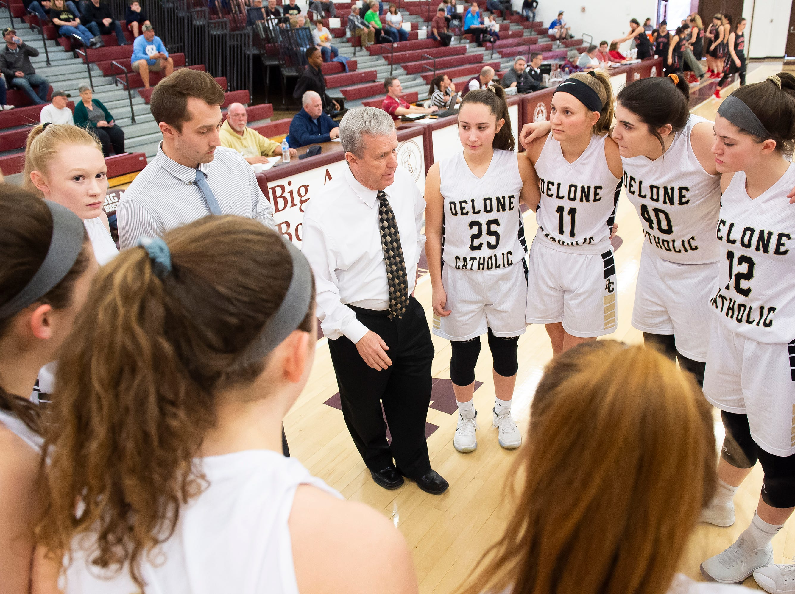 Delone Catholic head coach Gerry Eckenrode speaks with his team prior to a PIAA 3A quarterfinal game against Neshannock in Altoona, Pa., on Friday, March 15, 2019. The Squirettes won 50-41.