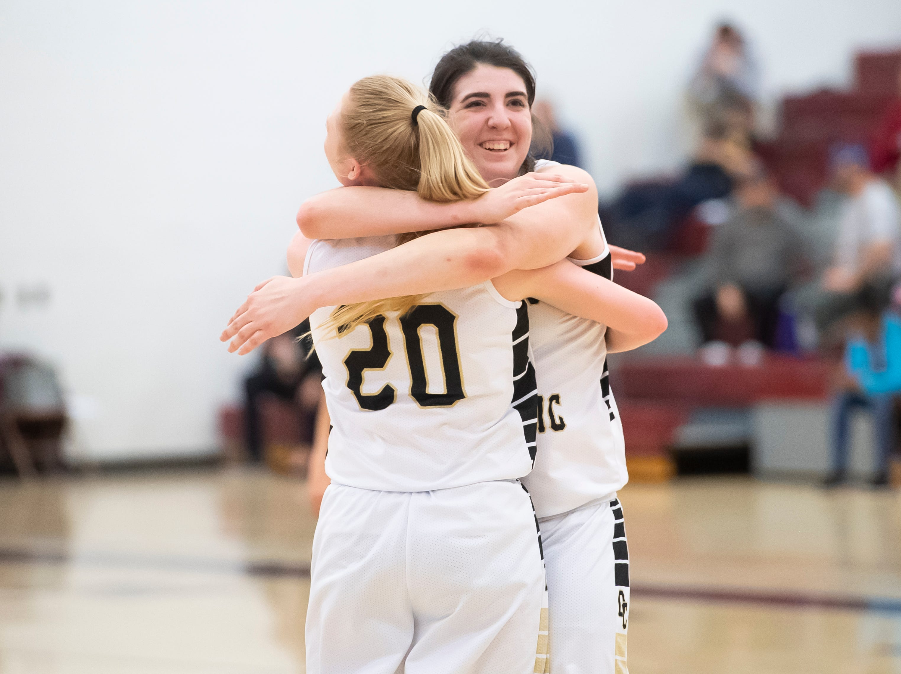 Delone Catholic's Bradi Zumbrum and Brooke Lawyer (20) celebrate after defeating Neshannock 50-41 during a PIAA 3A quarterfinal in Altoona, Pa., on Friday, March 15, 2019.