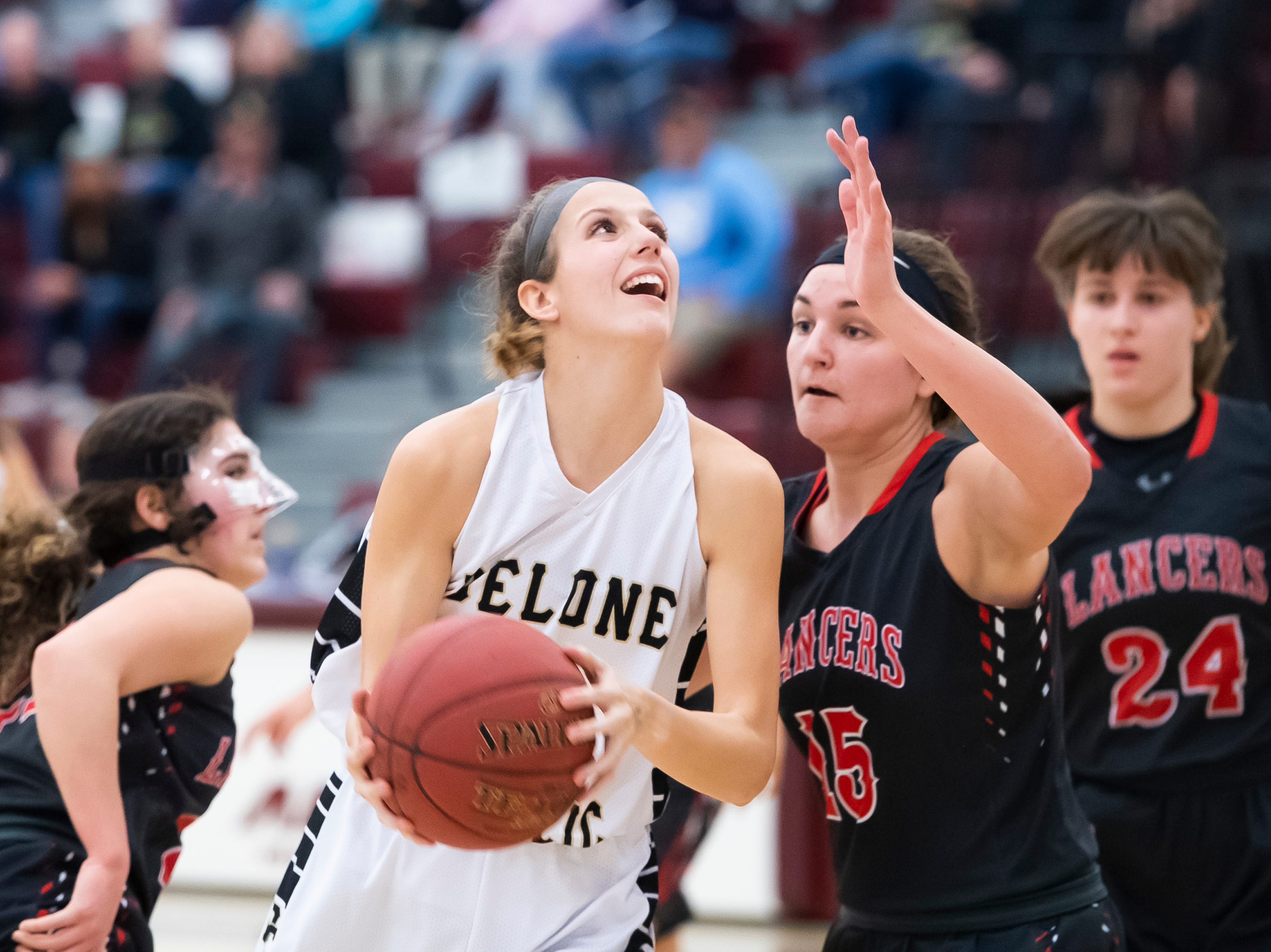 Delone Catholic's Maggie Wells looks to shoot against Neshannock during a PIAA 3A quarterfinal in Altoona, Pa., on Friday, March 15, 2019. The Squirettes won 50-41.