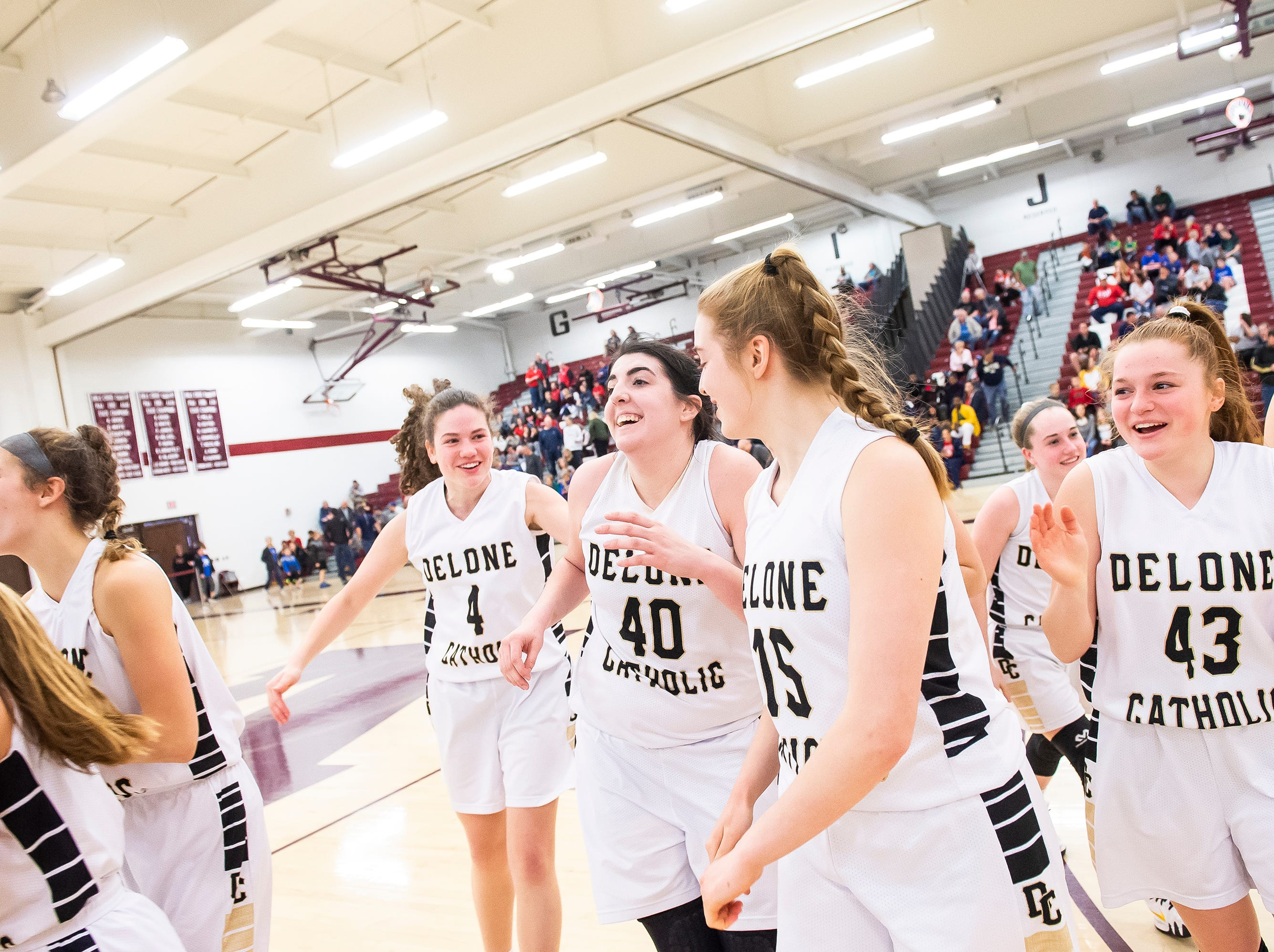 The Delone Catholic Squirettes celebrate after coming back to beat Neshannock in a PIAA 3A quarterfinal in Altoona, Pa., on Friday, March 15, 2019. The Squirettes won 50-41.
