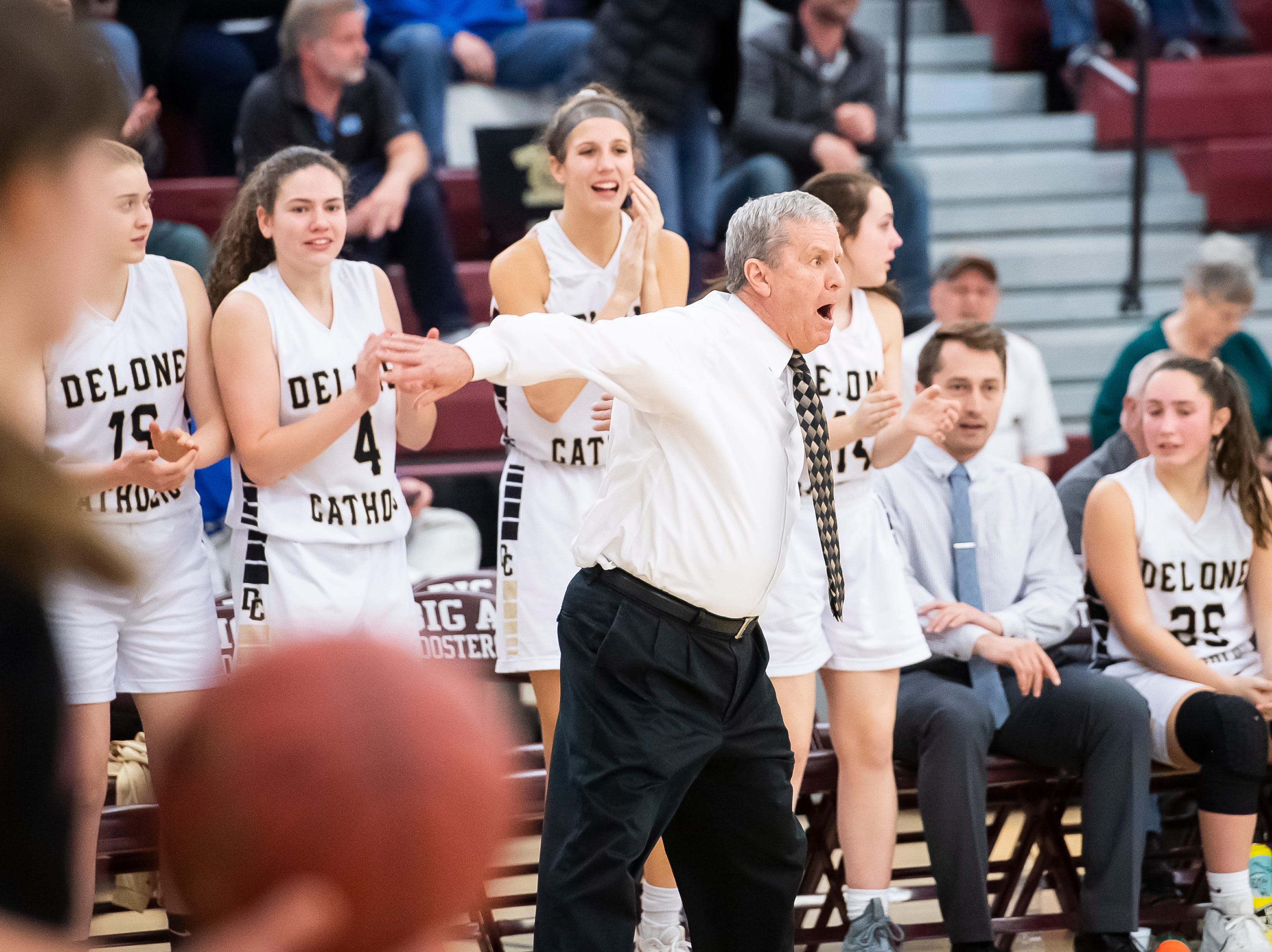 Delone Catholic head coach Gerry Eckenrode motions for his players to get back up to the ball after scoring against Neshannock during a PIAA 3A quarterfinal in Altoona, Pa., on Friday, March 15, 2019. The Squirettes won 50-41.