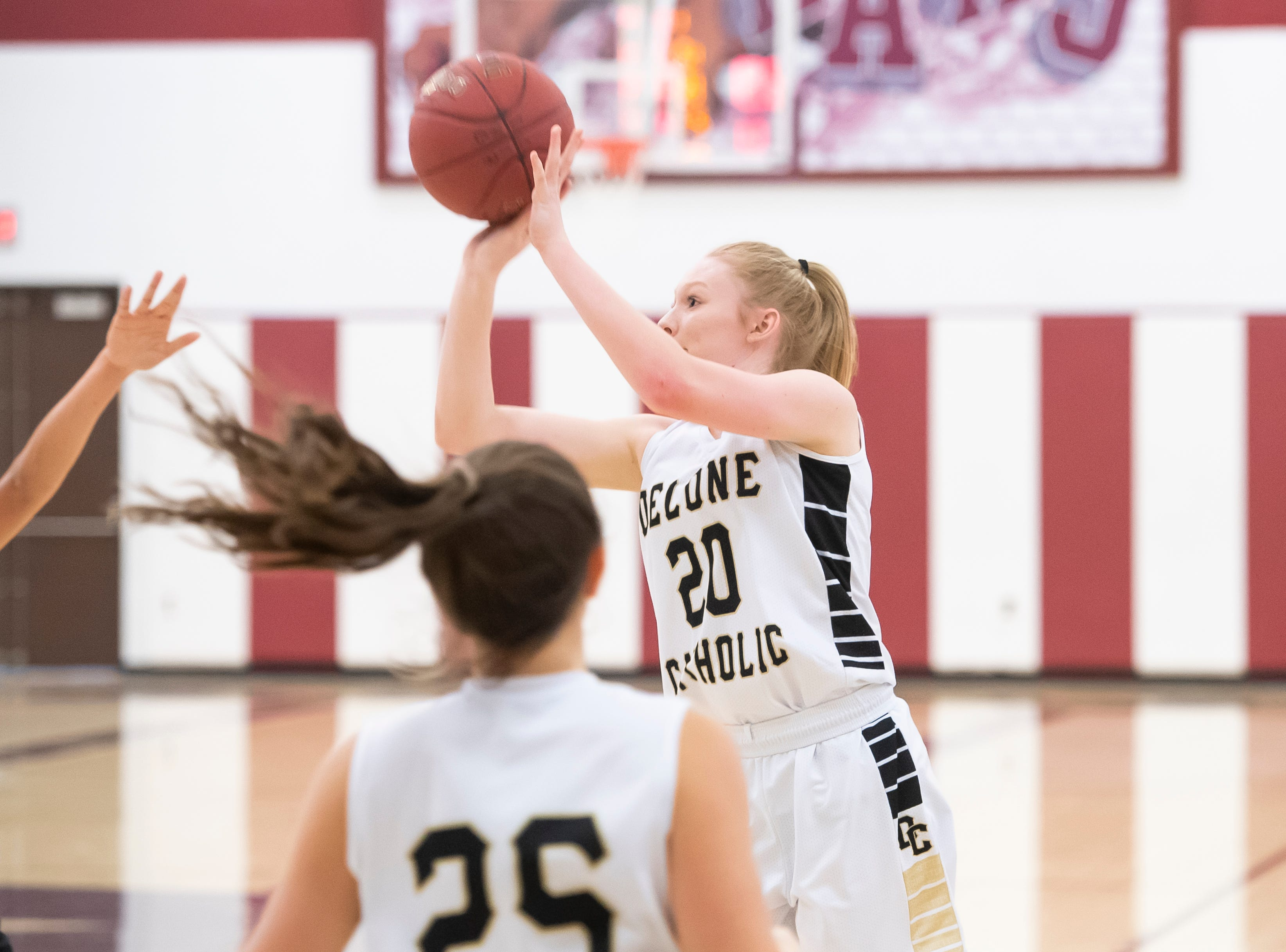 Delone Catholic's Brooke Lawyer takes a 3-point shot during a PIAA 3A quarterfinal against Neshannock in Altoona, Pa., on Friday, March 15, 2019. Lawyer finished the game with 11 points (including one 3-pointer) as the Squirettes won 50-41.