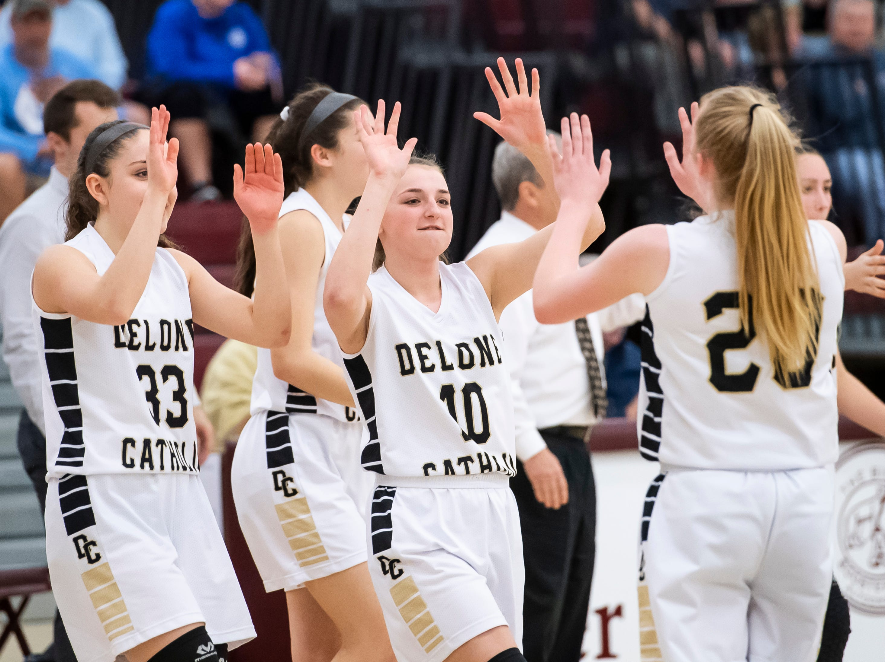 Delone Catholic players enter a timeout late in the fourth quarter against Neshannock during a PIAA 3A quarterfinal in Altoona, Pa., on Friday, March 15, 2019. The Squirettes won 50-41.