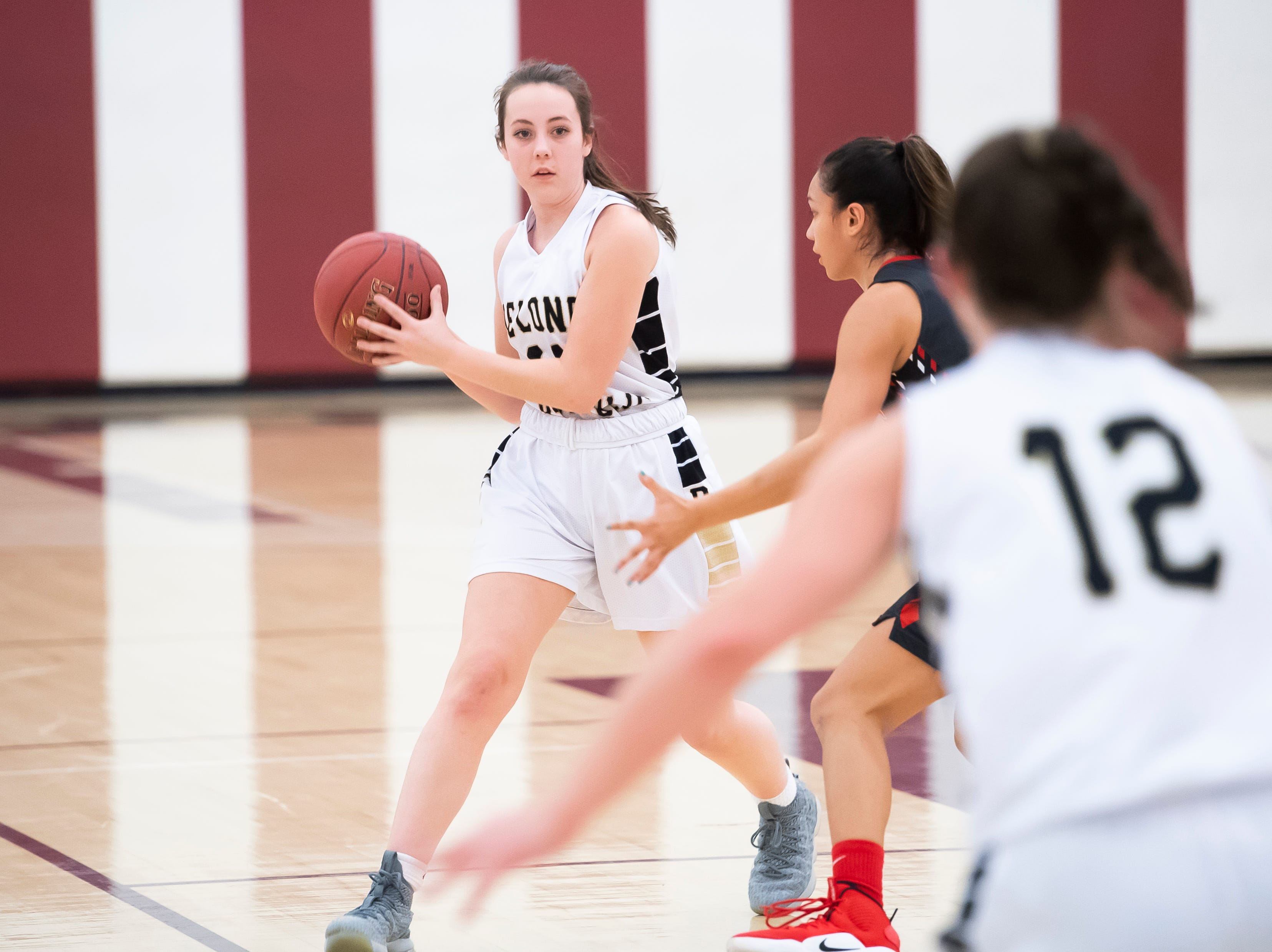 Delone Catholic's Dee McCormick looks to pass against Neshannock during a PIAA 3A quarterfinal in Altoona, Pa., on Friday, March 15, 2019. The Squirettes won 50-41.