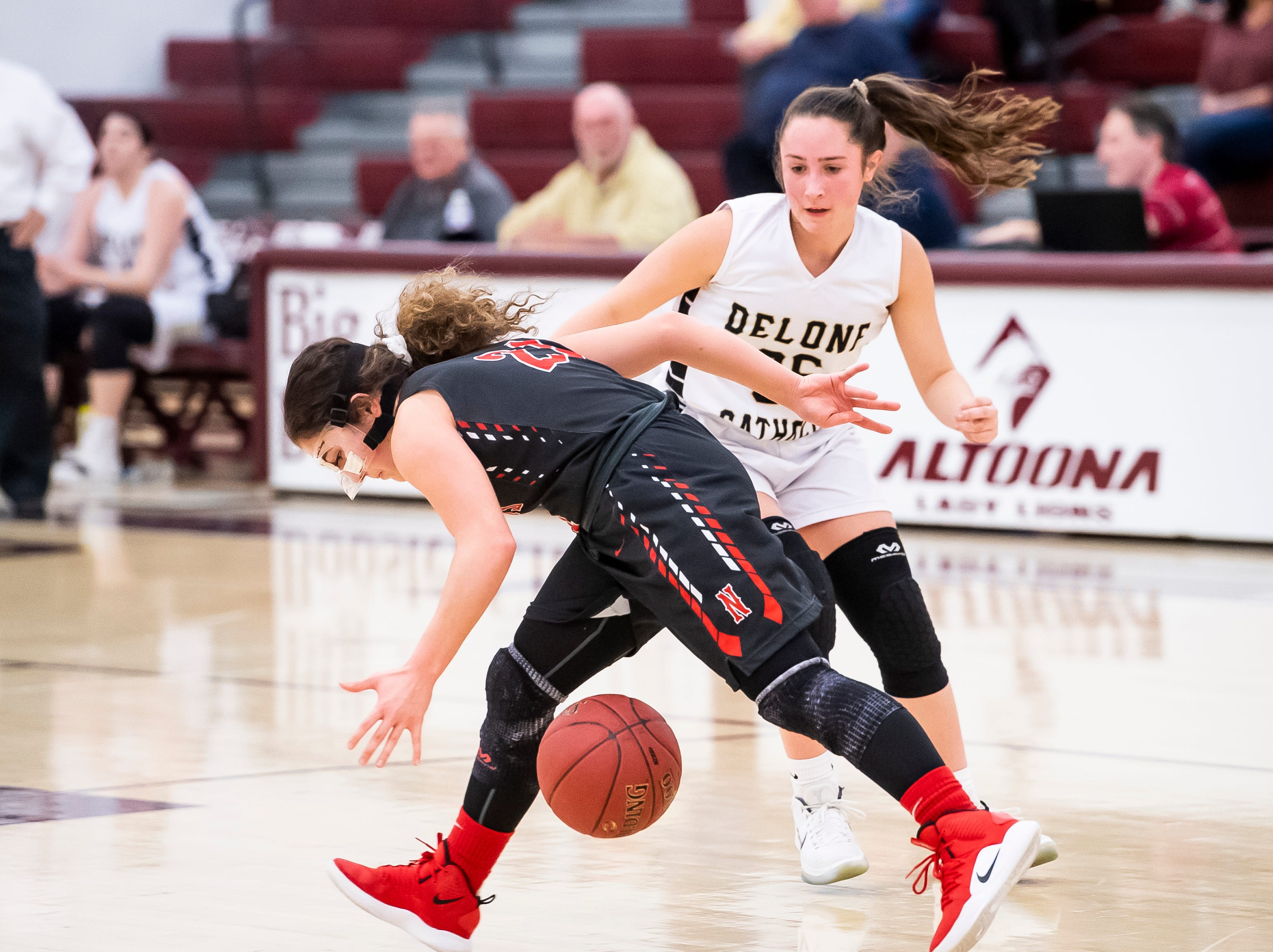 Neshannock's Ellina DeLillo temporarily loses control of the ball during a PIAA 3A quarterfinal game against Delone Catholic in Altoona, Pa., on Friday, March 15, 2019. The Squirettes won 50-41.