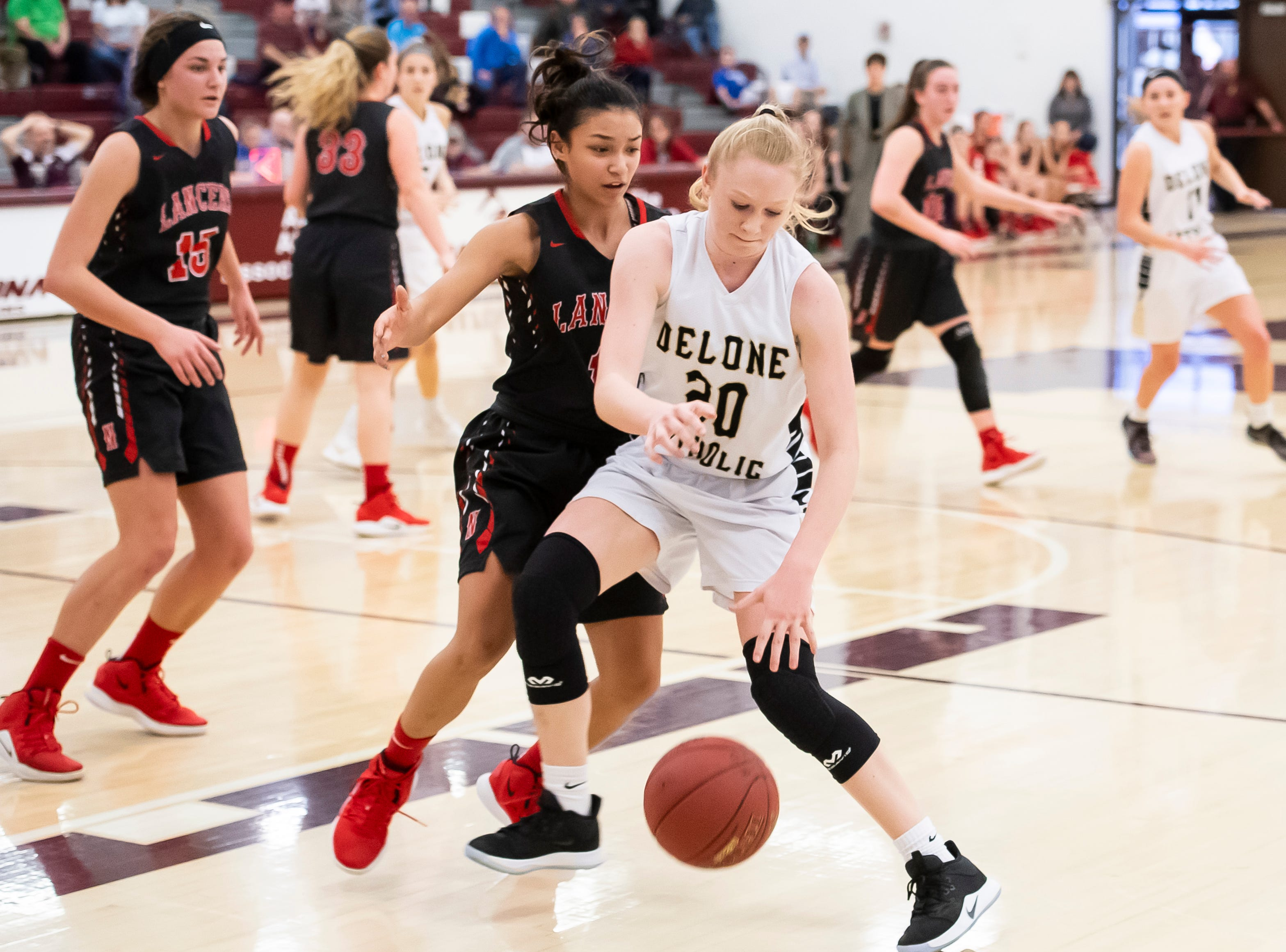 Delone Catholic's Brooke Lawyer dribbles against Neshannock's Neleh Nogay during a PIAA 3A quarterfinal in Altoona, Pa., on Friday, March 15, 2019. The Squirettes won 50-41.