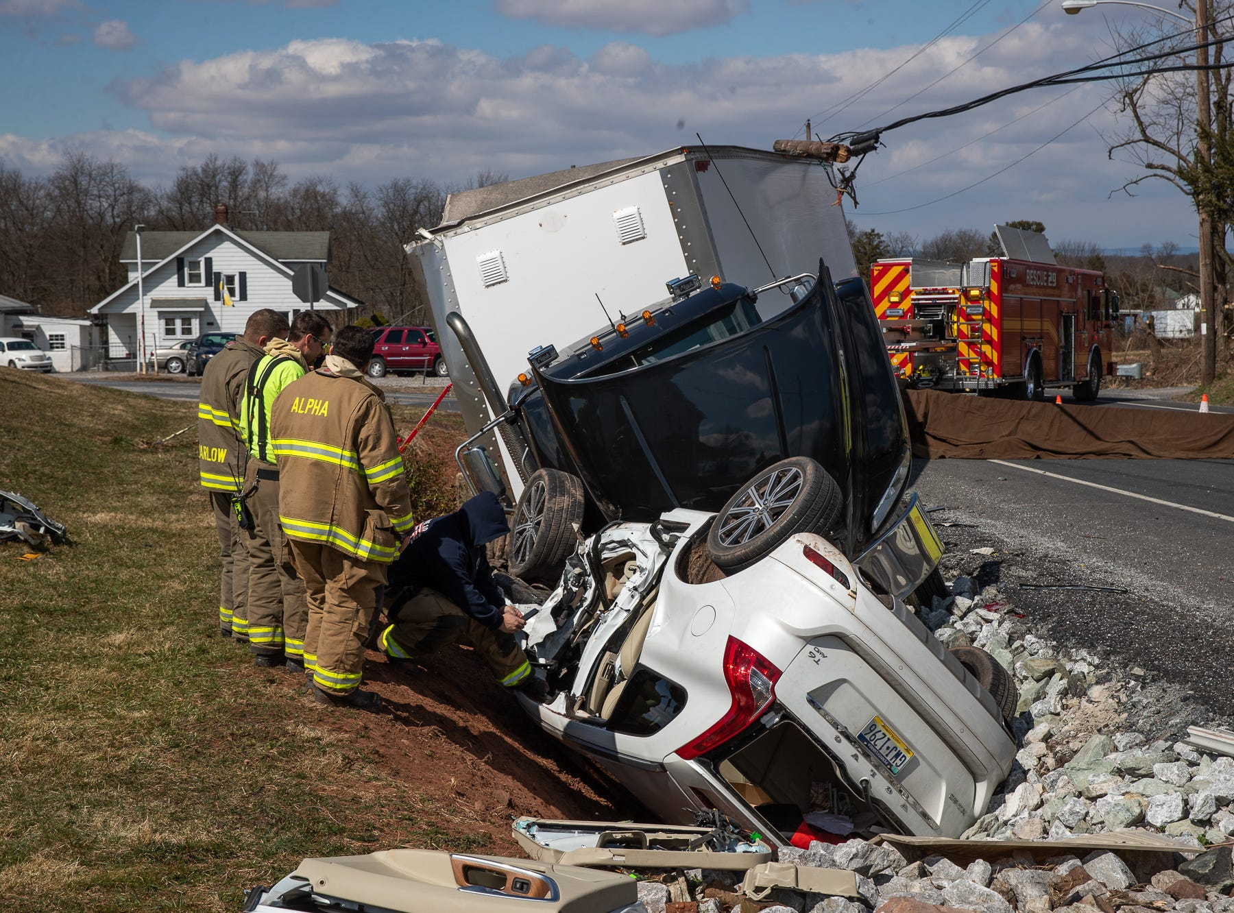 Crews work at the scene of a crash with heavy entrapment involving an overturned SUV and a tractor trailer on the 3600 block of Baltimore Pike, Saturday, March 16, 2019, in Mt. Joy Township. Littlestown Fire Chief Scott Small said one woman, the sole occupant of the SUV, was flown from the scene after a difficult extrication from the car. The driver of the tractor trailer did not suffer any major injuries, he said, and was able to crawl right out of the cab.