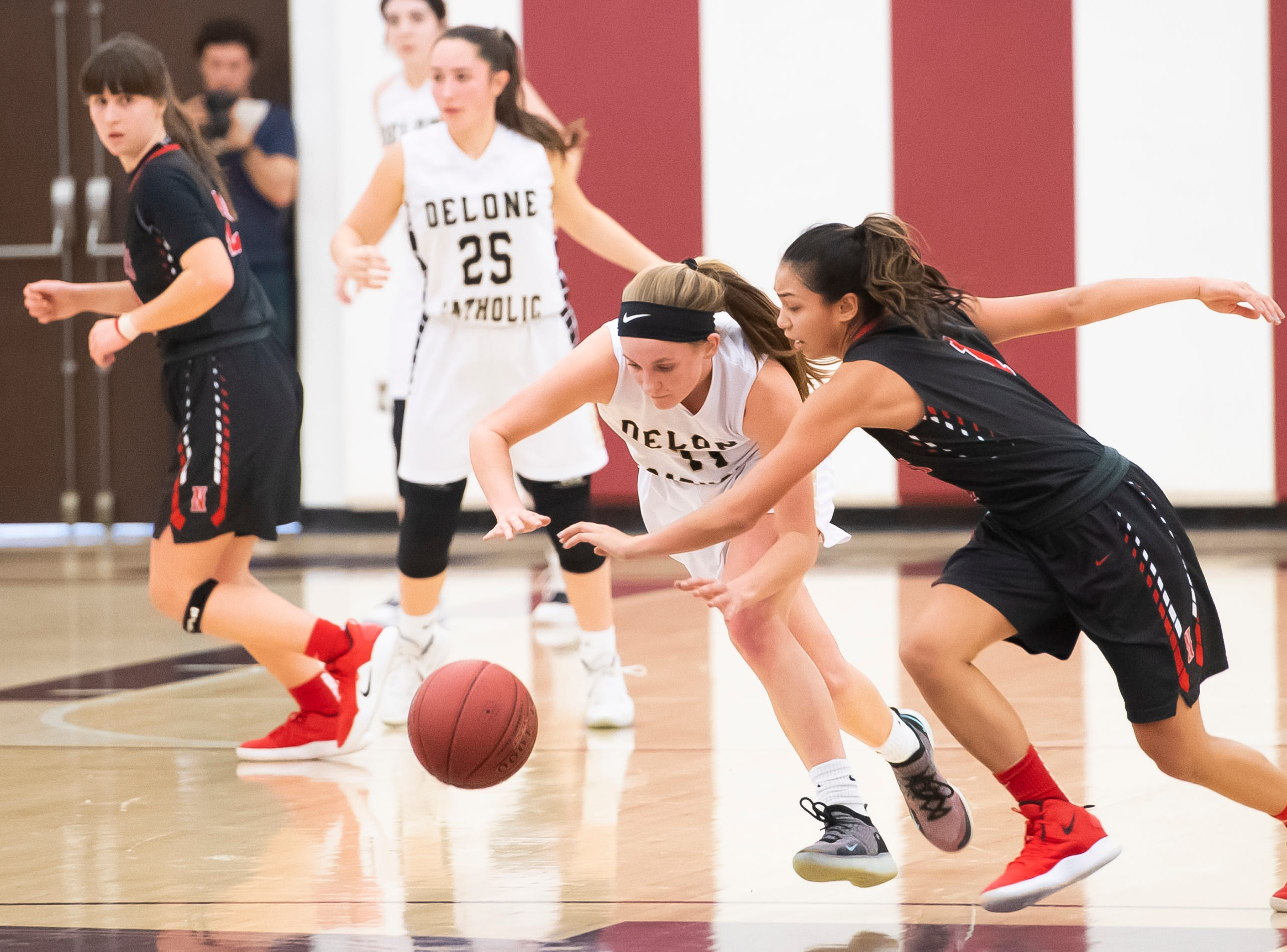 Delone Catholic's Riley Vingsen tries to make a steal on Neshannock's Neleh Nogay during a PIAA 3A quarterfinal in Altoona, Pa., on Friday, March 15, 2019. The Squirettes won 50-41.
